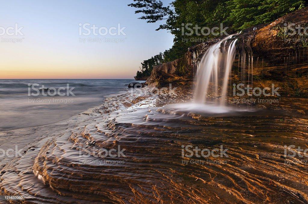 Waterfall at the beach. stock photo