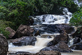 Waterfall, descending by rock formation, in the middle of green forest, Sao Paulo, Brazil - \