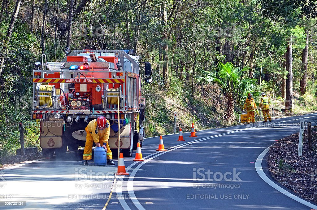 Waterfall fire brigade manage oil spill in Royal National Park stock photo