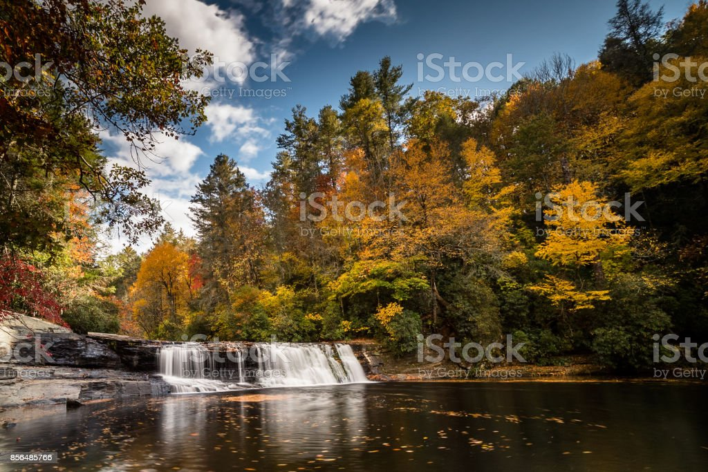 waterfall in a forest in fall colors stock photo