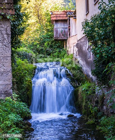 Martin Brod, Bosnia and Herzegovina - september 20 2019: Small waterfall next to the old house in village Martin Brod in Bosnia and Herzegovina