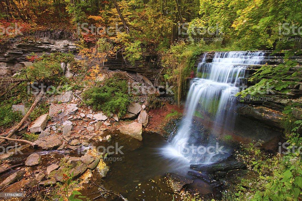 Waterfall in autumn foliage stock photo