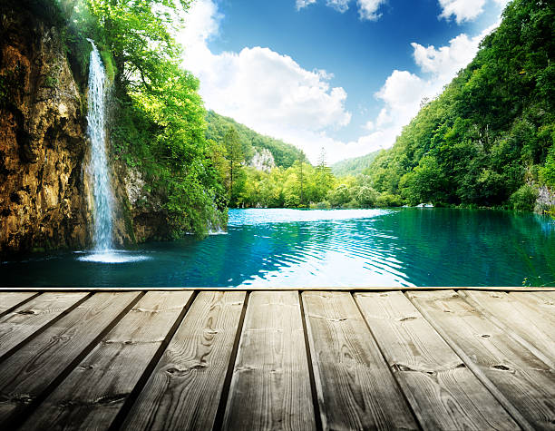waterfall in deep forest of croatia and wood pier - waterfall stock photos and pictures