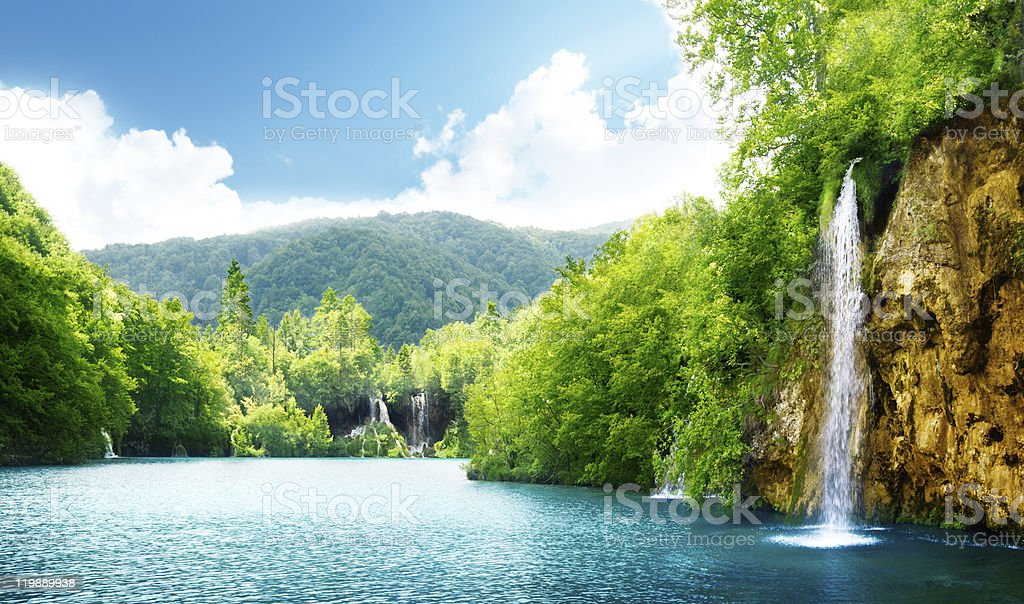 waterfall in deep forest stock photo