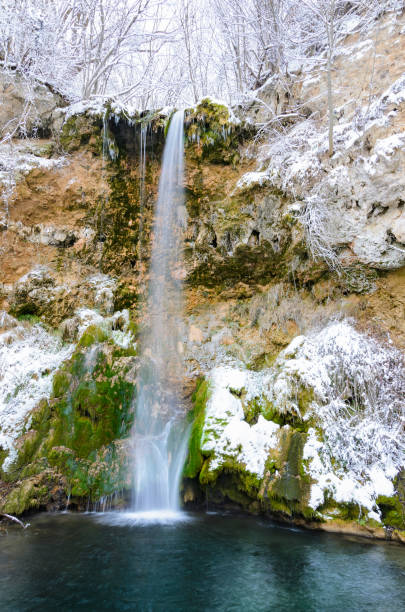 Waterfall in deep forest, Veliki buk in winter, Serbia stock photo