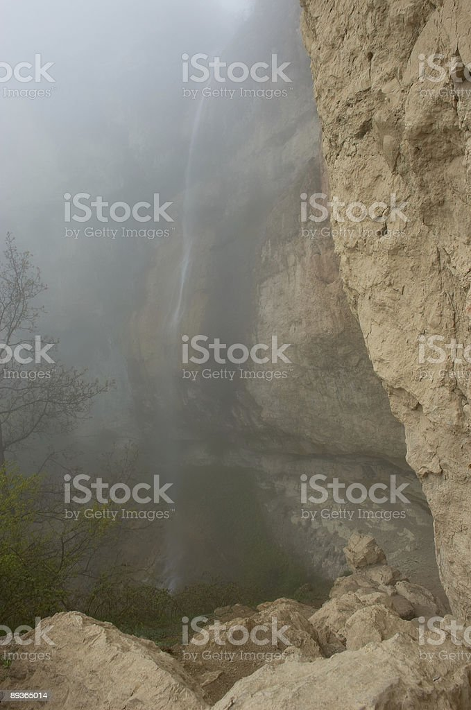 Waterfall in fog royalty-free stock photo