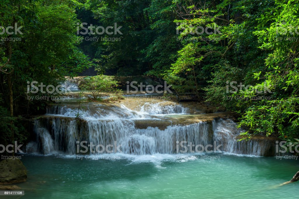 Waterfall in forest at Erawan waterfall National Park, Kanchanaburi, Thailand. stock photo