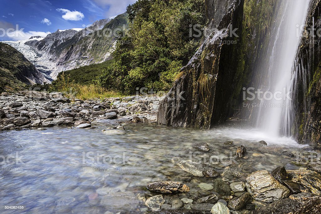 Waterfall in Franz Josef Glacier Valley stock photo