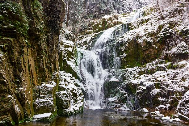 Waterfall in mountains. Famous Kamienczyk waterfall in the Karkonosze National Park in Sudety mountains – zdjęcie