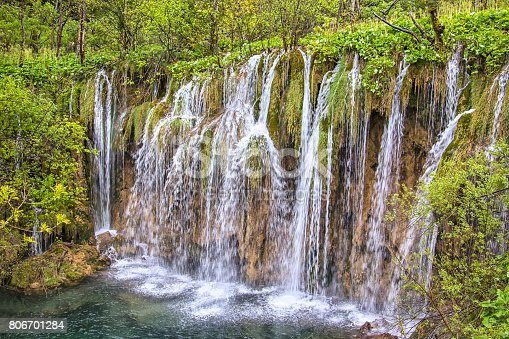 Fresh Springtime. View to the boardwalk at Plitvice Lakes (Croatia). In 1979 the Plitvice Lakes National Park was declared as an UNESCO World Natural Heritage site. The landscape looks like a green paradise.