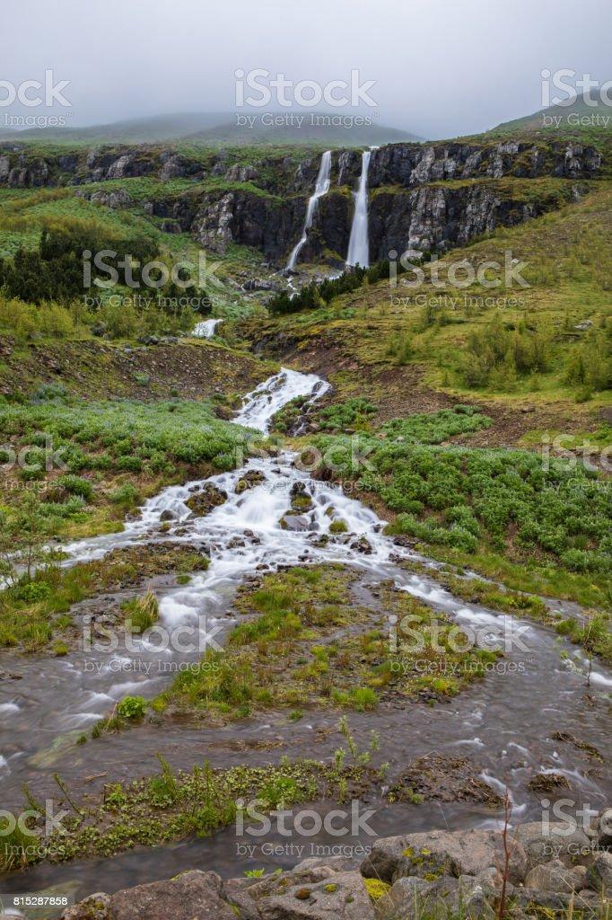 Waterfall in Seyðisfjörður, an Eastern Fjord town in Iceland stock photo