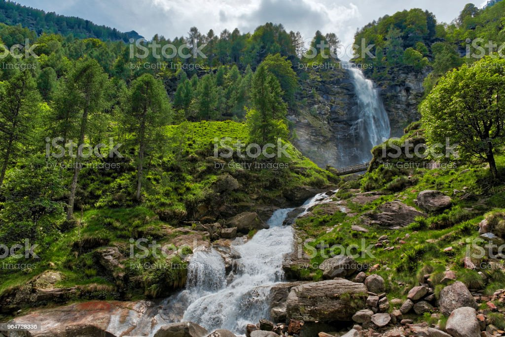 Waterfall in spring season and forest royalty-free stock photo