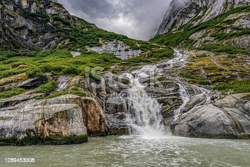 A waterfall in the Endicott Arm in the Fords Terror Wilderness in Alaska. This is a glacier created fjord.