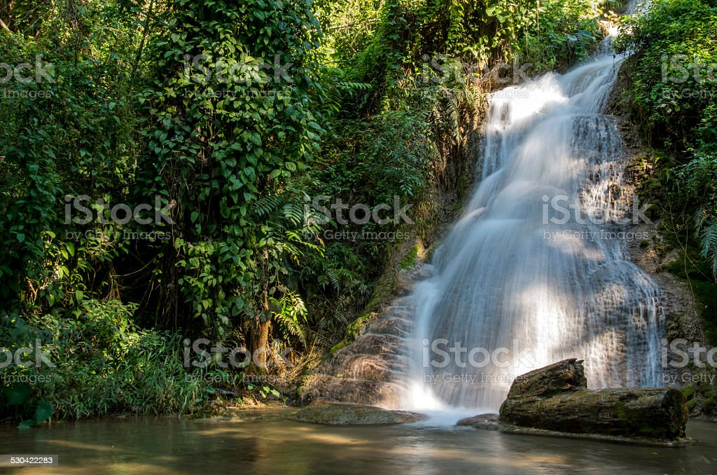 Waterfall in the jungle in Thailand stock photo