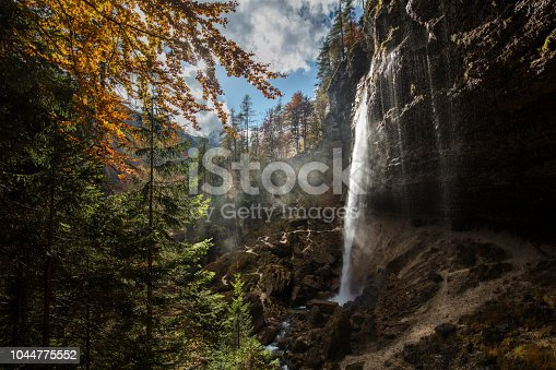 Natural waterfall in Julian Alps, Slovenia in autumn.