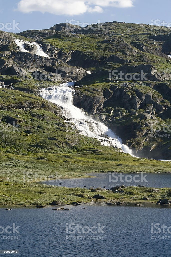Waterfall in the mountain royalty-free stock photo