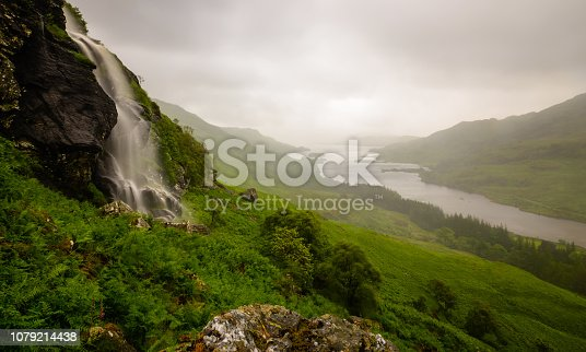 A large waterfall in the Loch Lomond and Trossachs national park in the highlands of Scotland