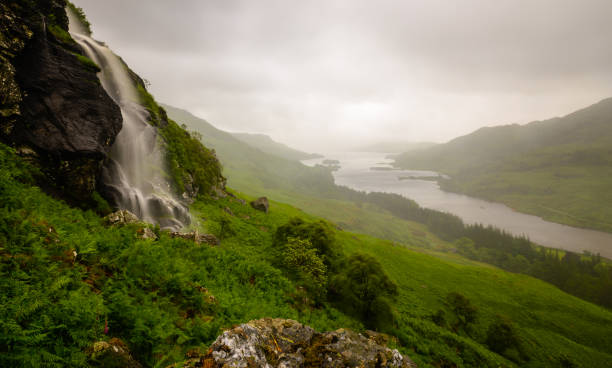 Waterfall in the Scottish highlands A large waterfall in the Loch Lomond and Trossachs national park in the highlands of Scotland inverness scotland stock pictures, royalty-free photos & images