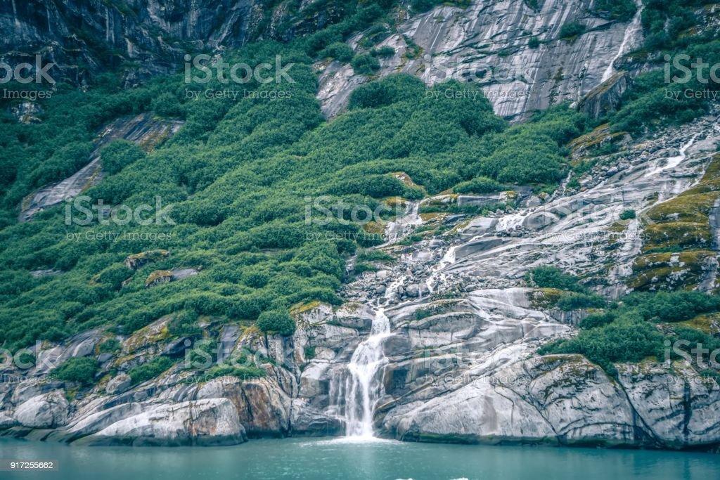 Waterfall in Tracy Arm Fjord, Alaska stock photo