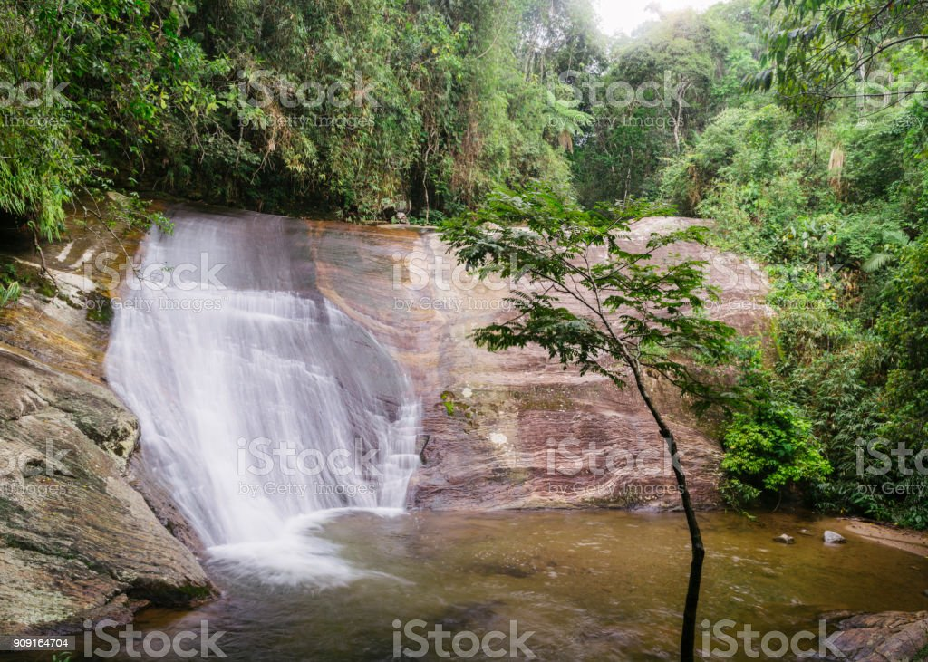 Waterfall in tropical rainforest in rural state of Rio de Janeir stock photo