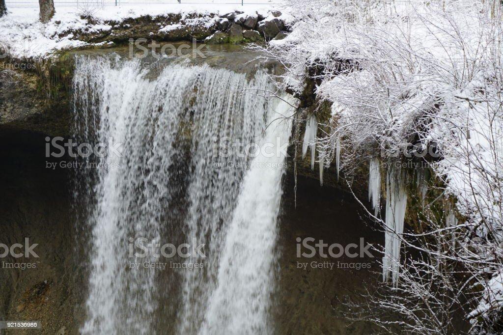 waterfall in winter time stock photo