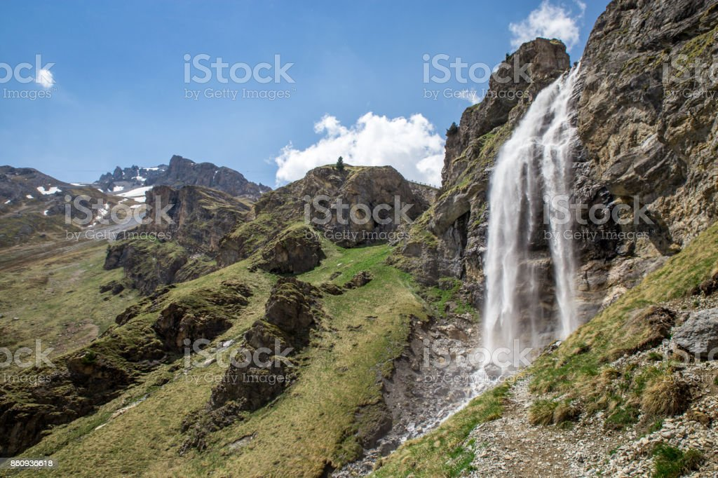 Waterfall near Sesvenna Cabin in the Alps, South Tyrol, Italy stock photo