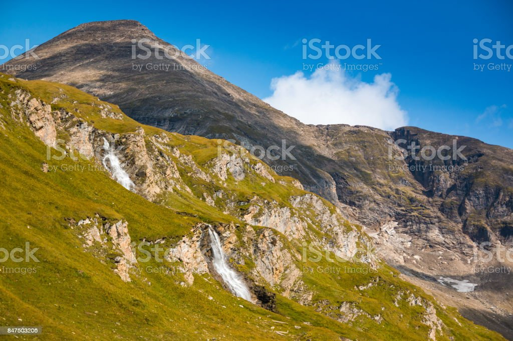 Waterfall next to Grossglockner High Alpine road in Hohe Tauern National Park stock photo