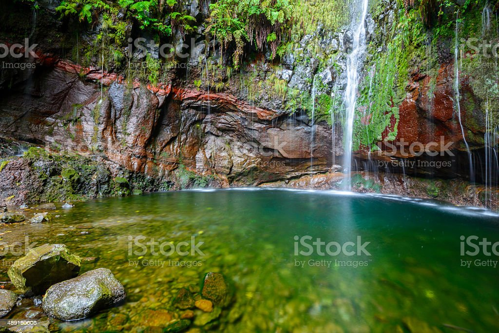 Waterfall of the Twenty-five Fountains Levada hiking trail, Madeira (Portugal) stock photo