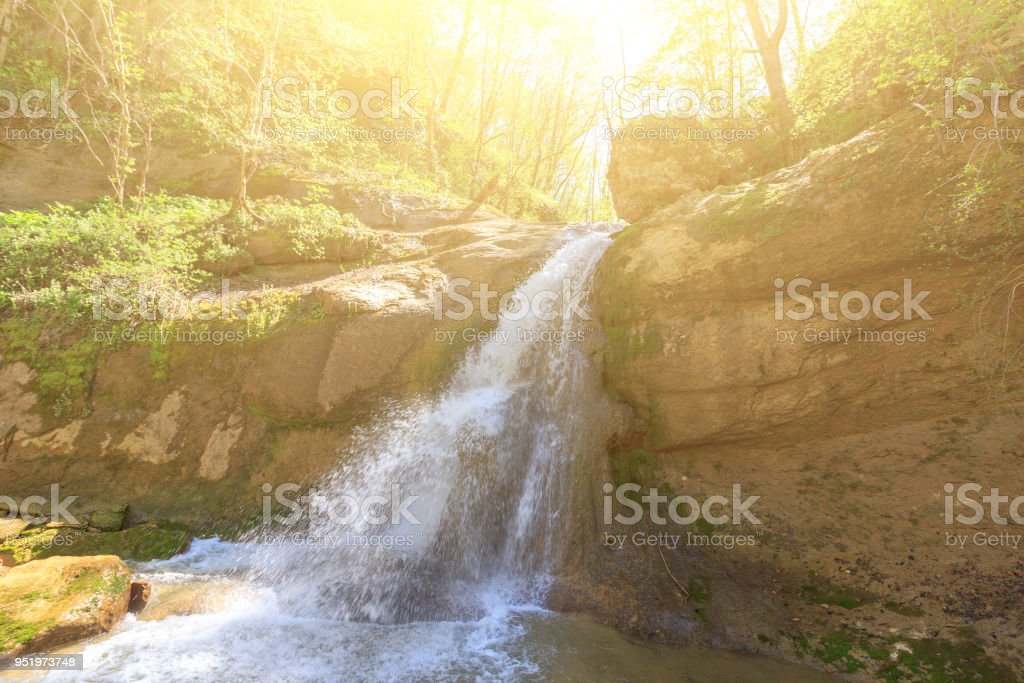 Waterfall on the Mishoko river in the Republic of Adygea spring Sunny morning stock photo