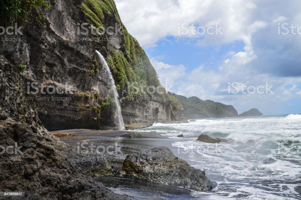 Waterfall on Wavine Cyrique beach, Dominica stock photo