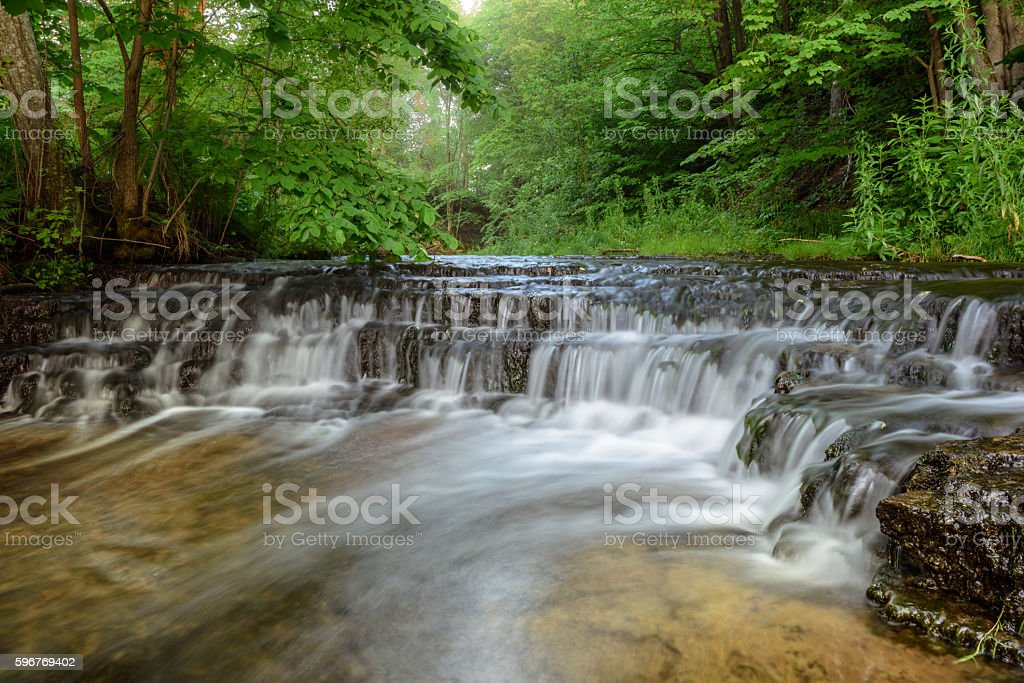 Waterfall over rock ledges stock photo