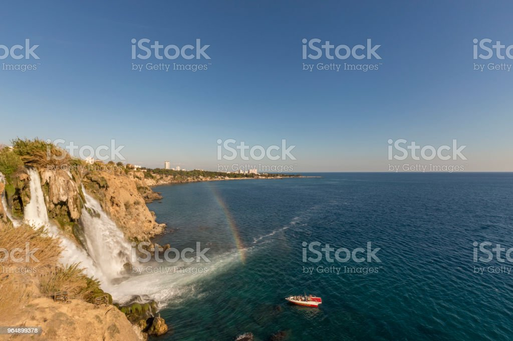 Waterfall, rainbow and boat royalty-free stock photo