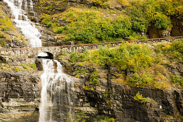 waterfall road glacier national park montana shale glacier melt - going to the sun road stock pictures, royalty-free photos & images