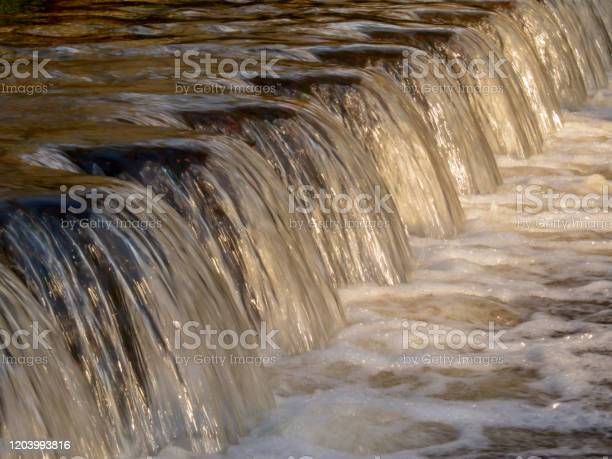 Photo of Waterfall Stream over Weir