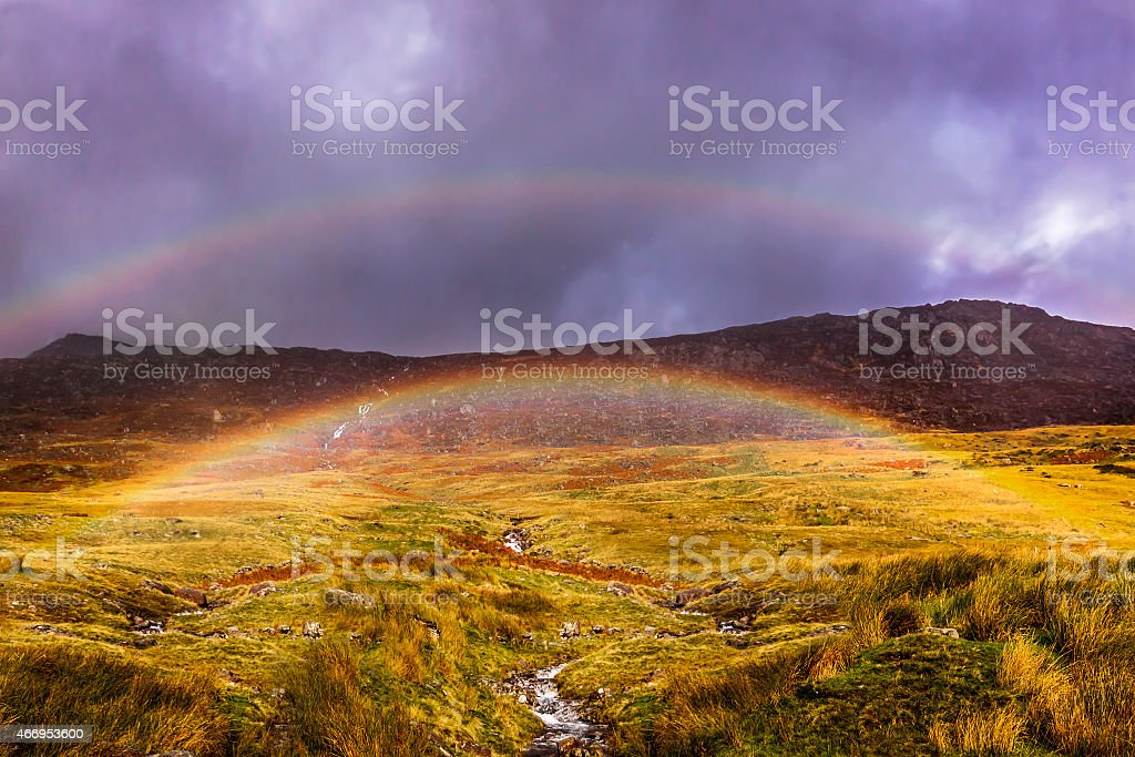Waterfall streams down a mountain in Snowdonia stock photo