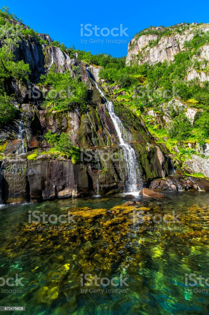 Waterfall Trollfjord (Trollfjorden) in the Lofoten Islands, Norway stock photo
