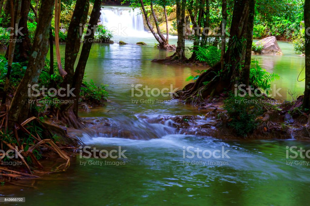 Waterfall with blue  water and rain forest stock photo