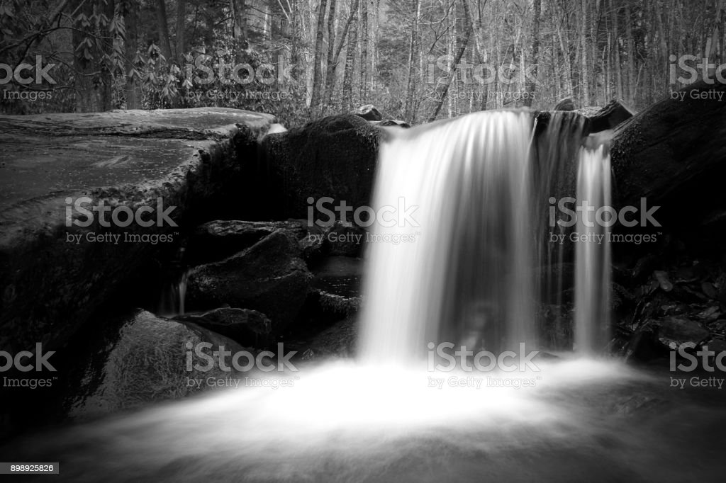 Waterfall with Moss Covered Stones in the Woods. stock photo