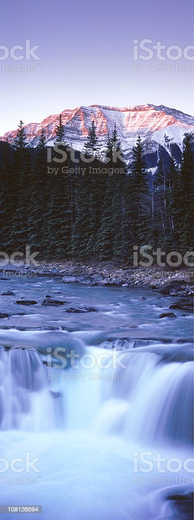 Waterfall with Mountain in background royalty-free stock photo