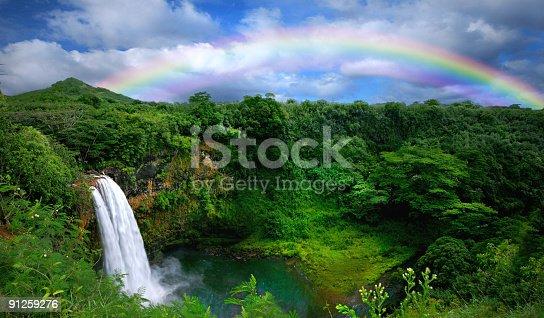 istock Waterfall With Rainbow in Kauai 91259276