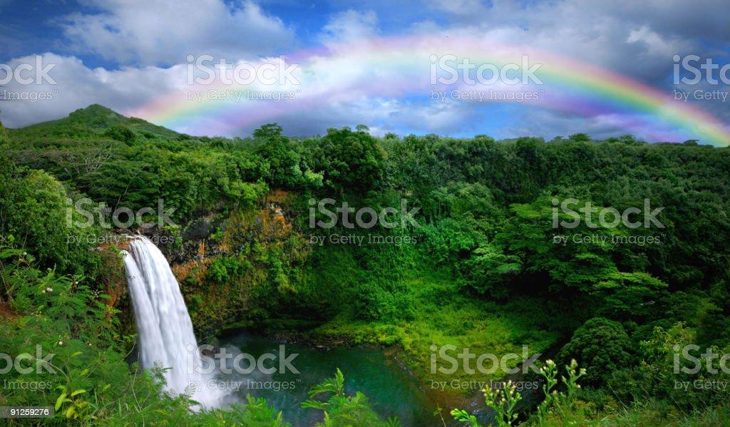 Waterfall With Rainbow in Kauai stock photo