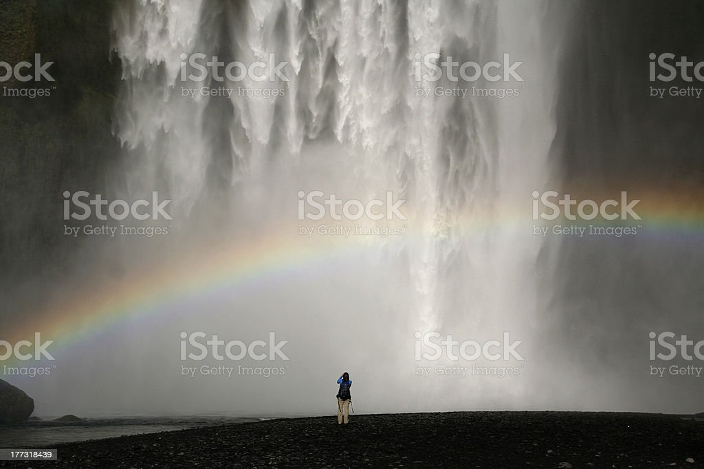 Waterfall with rainbow stock photo