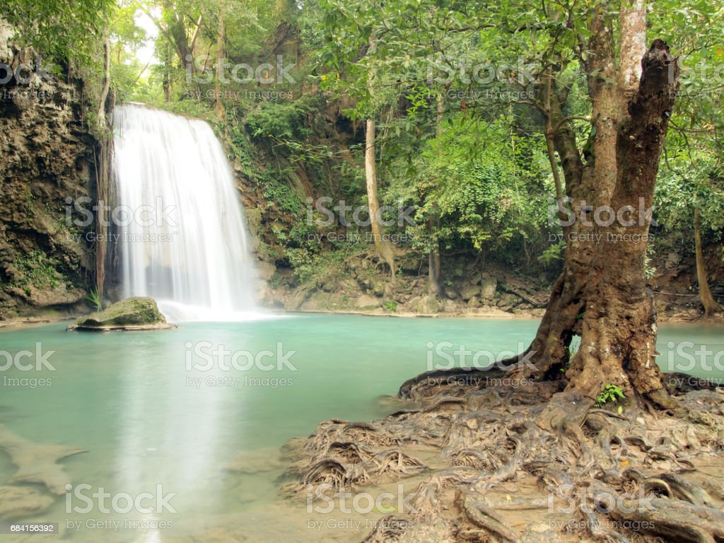 Waterfall with water flowing around royaltyfri bildbanksbilder