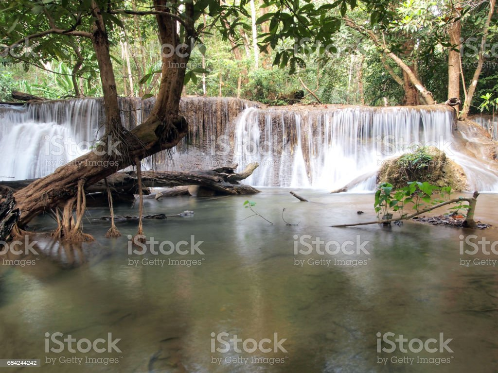 Waterfall with water flowing around royalty-free stock photo