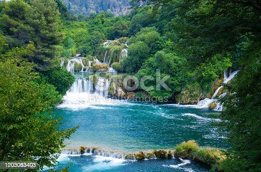 Beautiful river waterfalls among green plants, trees and forests In Krka National Park, Dalmatia, Croatia, Europe