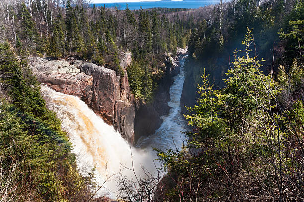 waterfalls and boreal forest stock photo