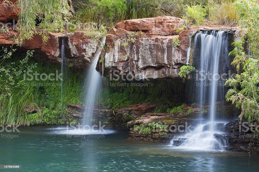 Waterfalls at fern Pool in Karijini National Park, Western Australia stock photo