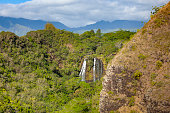 beautiful twin waterfalls at kauai island at hawaii islands, usa.