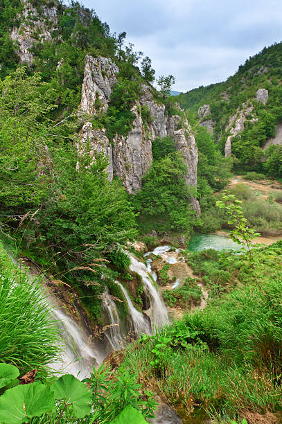 waterfalls at national park. plitvice, croatia, popular touristic destination - plitvice lakes stockfoto's en -beelden