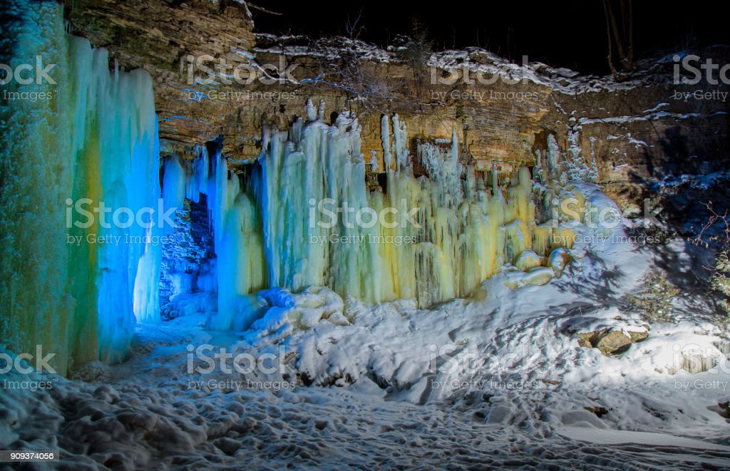 Waterfalls frozen into Ice Caves stock photo